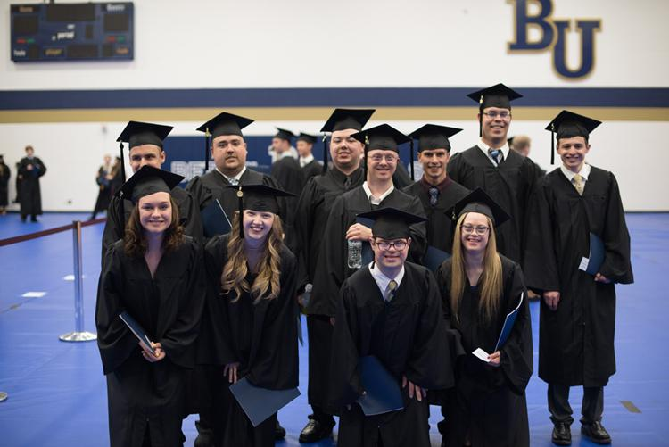 Graduating students from the Bethel University Inclusive Learning and Development (BUILD) program, a two-year postsecondary, residential program for students with physical and intellectual disabilities.
